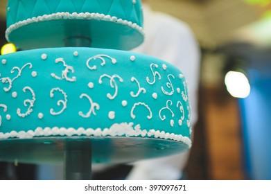 blue wedding cake with white cream ornament