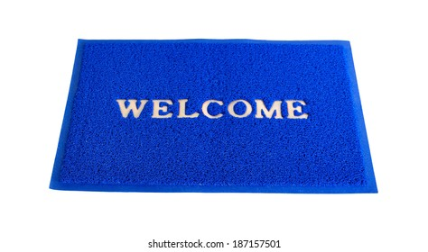 Blue welcome door mat isolated on white with clipping path.