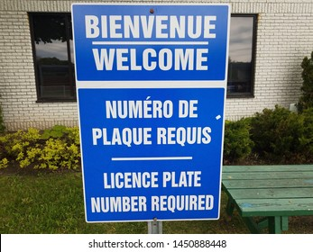 blue welcome license plate number required in French and English