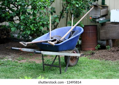 Blue wheelbarrow containing tools