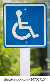 Blue wheelchair sign on the post