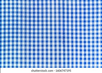 Blue and white abstract checkered fabric pattern, tablecloth texture background