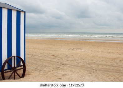 Blue white beach cabin on an empty beach early in the morning (shot on the Belgian coast)