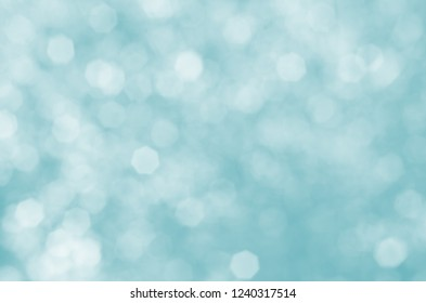 Blue and white bokeh. Soft focus background with cold, snowy appearance.