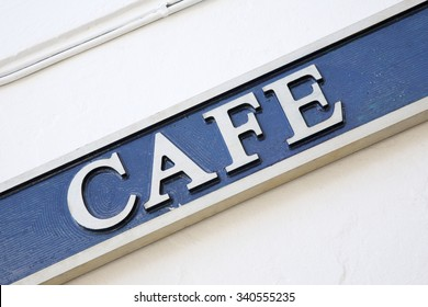 Blue and White Cafe Sign on Diagonal Tilt