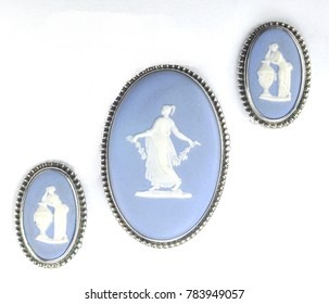 Blue and white cameo brooch and matching earrings in silver