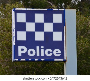 Blue and white chequered police sign outside a station in Victorian state in Australia