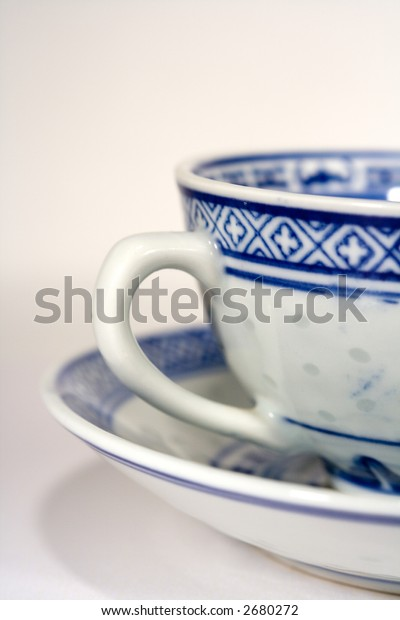 Blue and white china tea cups shot close up.