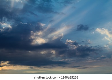 Blue and white clouds with scenery sun beams in the summer