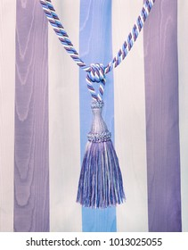 blue and white cord with tassel