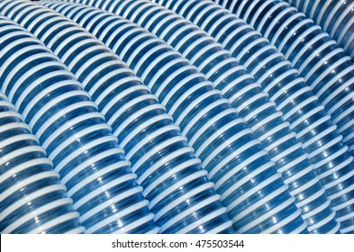 Blue and white corrugated plastic hose as background