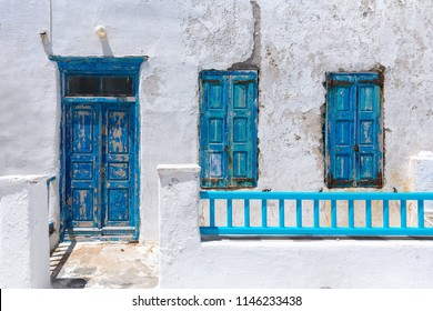 The blue and white of the Cyclades in Greece: blue windows and door on a abandoned building
