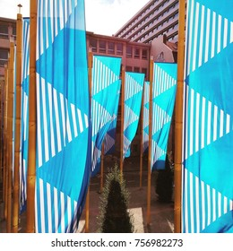Blue and white flags are seen outside a building in Brussels, Belgium.