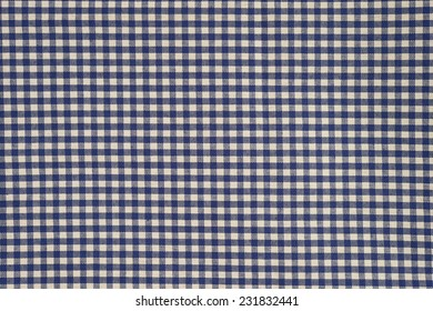 blue and white gingham cloth background with fabric texture.