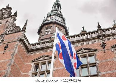 Blue and white with hearts flag of the Groningen university. The Flag of the province of Friesland. Blue with seven red seeblatts frisian flag. The Netherlands, Groningen.