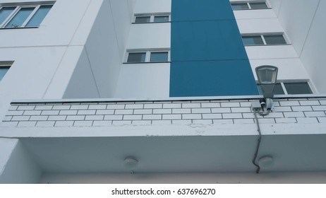 blue and white high-rise building,view from below.