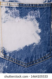 Blue and white Jeans back pocket texture close up