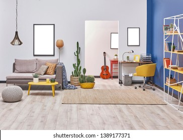 Blue and white living room decoration style with sofa frame and yellow bookshelf.