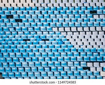 blue and white old plastic sport seat grandstand outdoor in an empty stadium. Some seats are crash collapse.