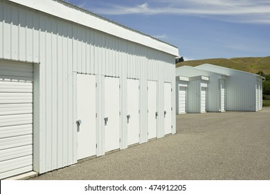 Blue and white outdoor self storage units.