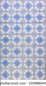 Blue and white patterned portugese tiles texture with floral and geometric motifs