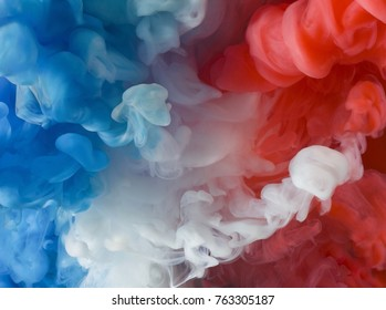 Blue, white and red paint in water. Flag of the Netherlands (Dutch flag) Also flag of France (French)