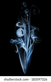 Blue and white smoke curls isolated on black