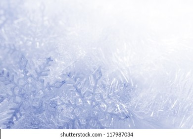 Blue and white snowflakes on a blue and white background