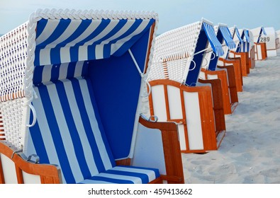 Blue and white striped roofed wicker beach chairs in Zingst at the Baltic Sea, Germany