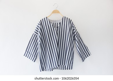 Blue and white striped shirt women isolated on white background