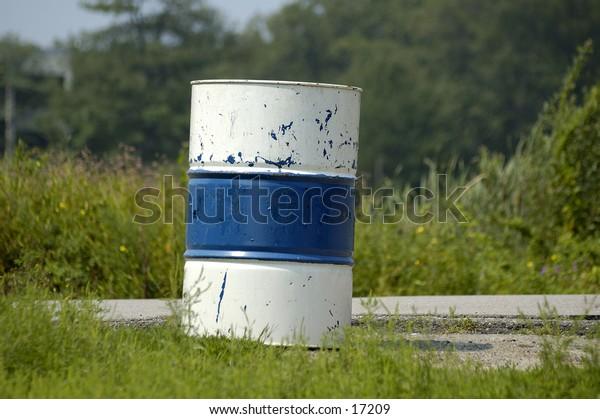 A blue & white striped trash can
