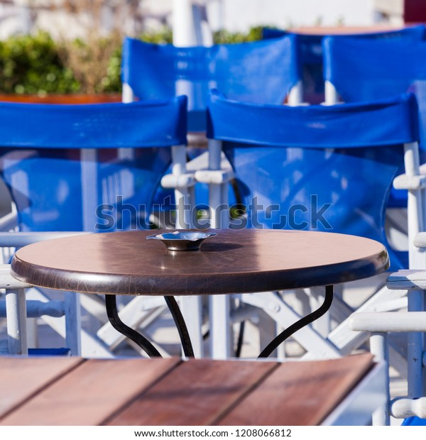Terrific Blue White Table Chairs Open Cafe Stock Photo Edit Now Alphanode Cool Chair Designs And Ideas Alphanodeonline