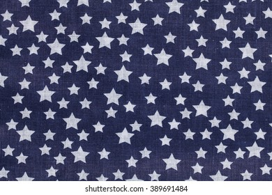 blue and white tablecloth picnic texture with stars. Textile, napkin, tablecloth. View from above, top. Traditional pattern and color.