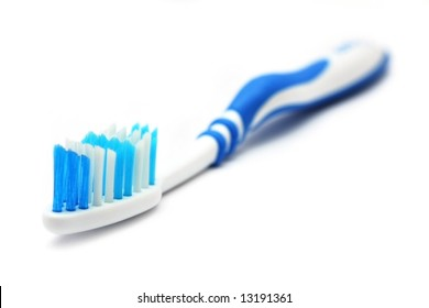 A blue white tooth brush on white background.
