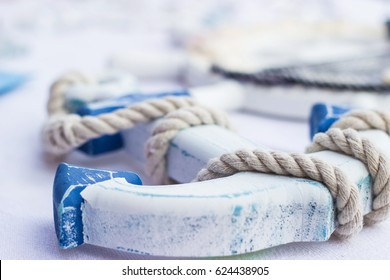 Blue and white wooden anchor and rope table home wall decoration