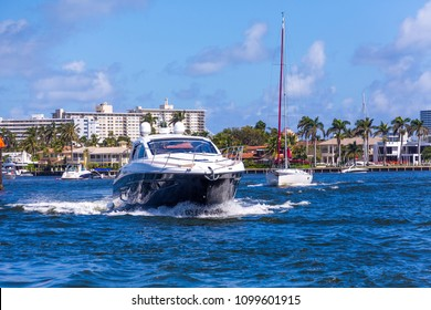 Blue and White Yacht Motoring the Intracoastal Waterway