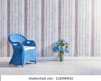 blue wicker summer chair and vase of flower decorative wallpaper in the room.