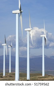 blue windmills group in a mountainous area