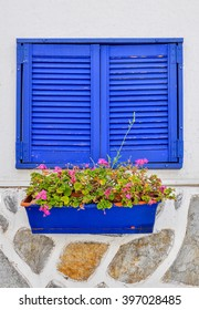 Blue window and flowers from Bodrum. Mugla, Turkey