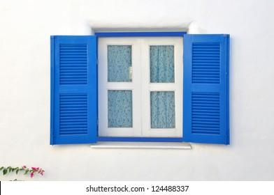Blue Window on white House in Greece