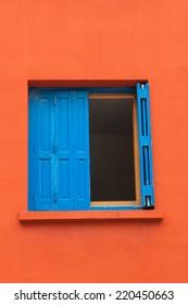 Blue window in red wall
