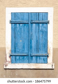 Blue window shutters.