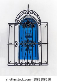Blue window with styled iron grid