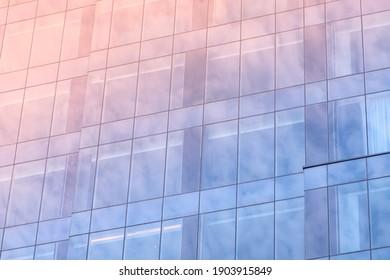 Blue windows of modern office skyscraper closeup. Real estate lease, rent, sale concept
