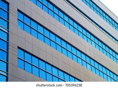 blue windows office building modern financial architecture geometric angles skyscraper