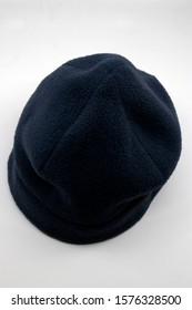 Blue winter hat in white background
