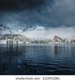 Blue winter lake under the mountains. Dark sky and water. Slovakia, Strbske pleso