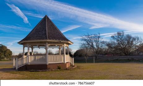 a blue winter sky over a gazebo