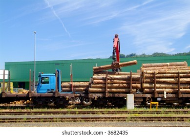 a blue wood crane with tree trank