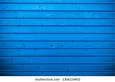 Blue wood panel background, abstract plank for texture. Natural photo.